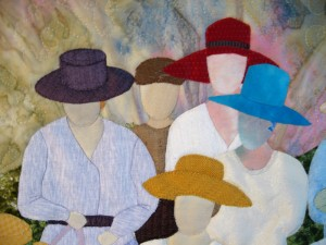 Detail of The Ladies art quilt, showing a close-up of the hats and faces.