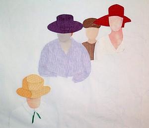 Four ladies in various stage of dress.