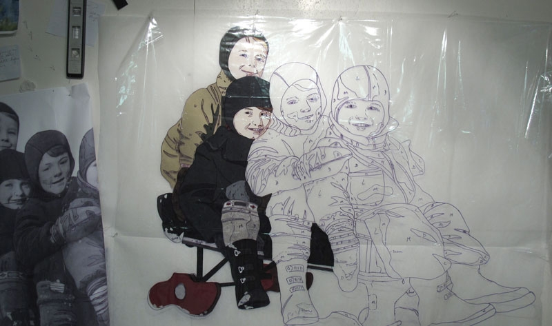 Picture showing part of the enlaged photo of four small boys on a sleigh and the line tracing.