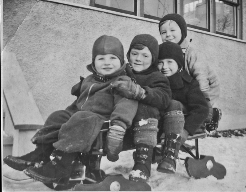 Original photograph of four kids on a sleigh.