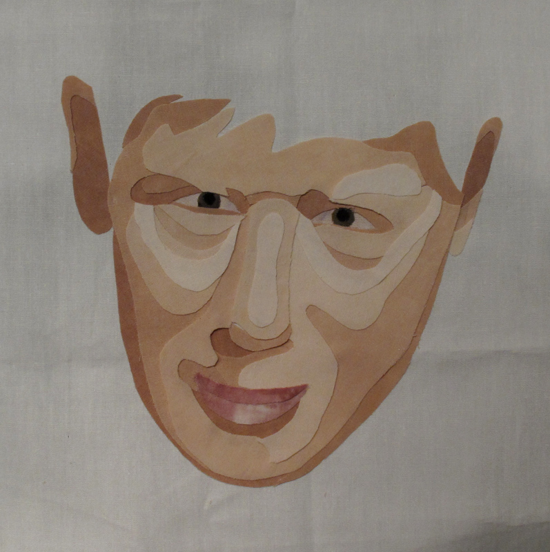 Boy's face recreated in fabric.