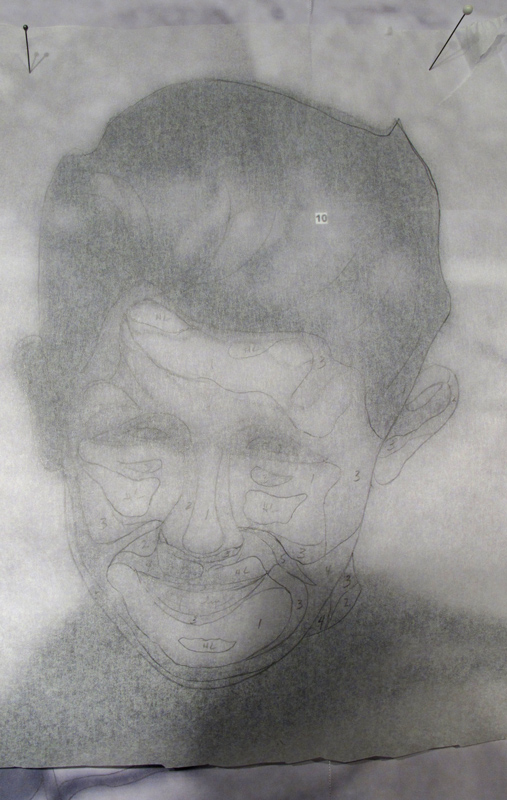 Photo showing the tracing of a boy's facial expressions.