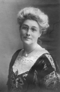 A lady wearing a lacy gown.