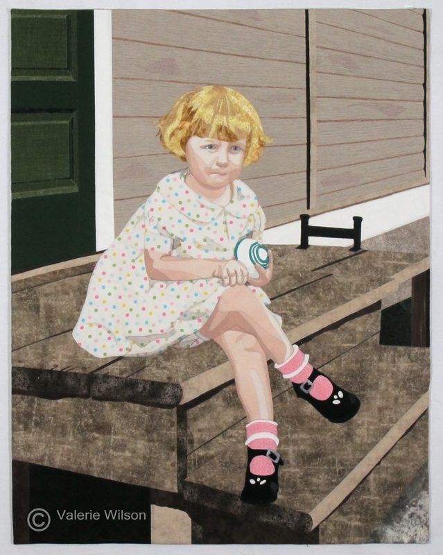 One of my portraits in fabric of a little girl sitting on a doorstep. - Valerie Wilson