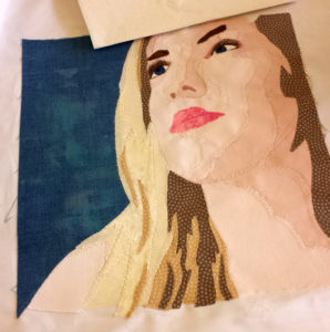 Fabric portrait of a young woman by a student of the Facial Expressions Workshop
