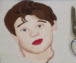 Fabric portrait of a young boy by a student of the Facial Expressions Workshop