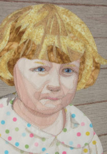 Fabric portrait of a little girl. It realts to the text on how to create a fabric portrait