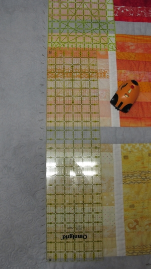 Picture showing one step in straightening a quilt