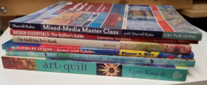 stack of art quilting books